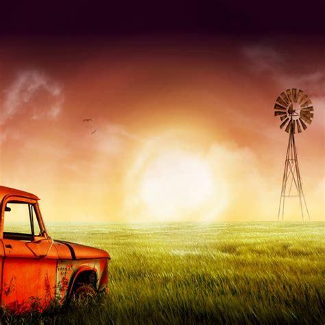 Orange Old Car On A Green Field
