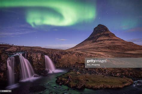 Kirkjufell Mountain And The Aurora Borealis In The