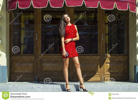 Beautiful Woman In Red Dress In The Shop Stock Photo Master Bedroom With Gray Carpet Converter Calculator Carpets Salisbury Area Aaa Cleaning Vernon Bc Cleaners Wilmington Ohio M Z Hours Best Type Of Uk Heather Twist