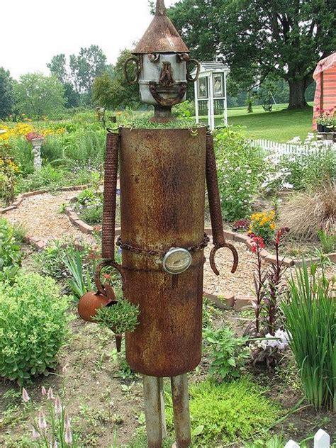 tin man bloom    planted garden art garden
