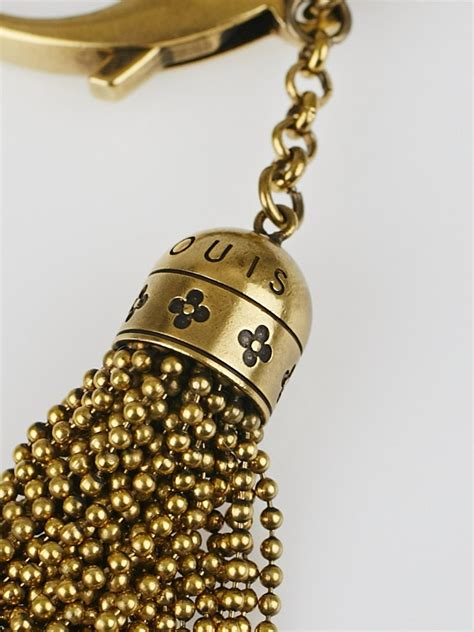 louis vuitton antique brass crystal monogram tassel caprice key holder  bag charm