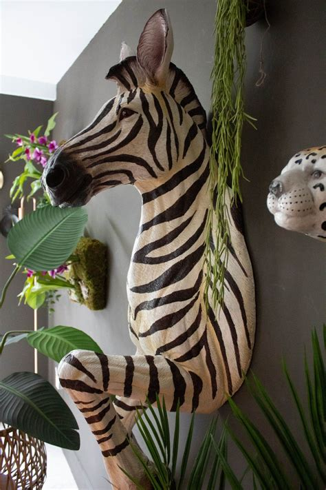 Carved wood animal head can transform a plain room into a unique and inviting space with just as little as a wall hanging. Wall Mounted Running Zebra   Animal heads on wall, Animal wall mount, Zebra