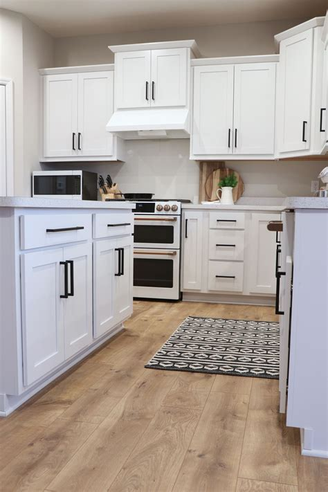 While stainless steel is undoubtedly the most popular appliance finish for a kitchen, black. Modern Farmhouse Kitchen, with white cabinets and black hardware, and farmhouse style accents ...