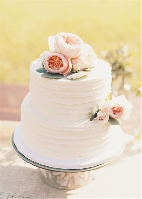 texture for buttercream cake add asymmetrical floral embellishments from florist that
