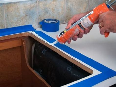 how to caulk a kitchen sink how to install a kitchen sink bob vila