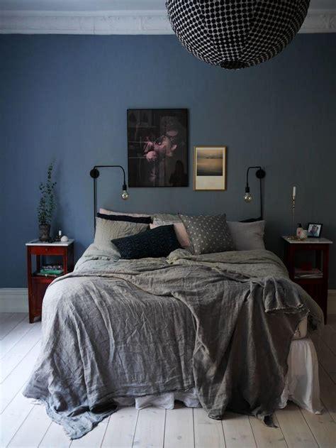 dark  moody bedroom  navy blue painted walls dark