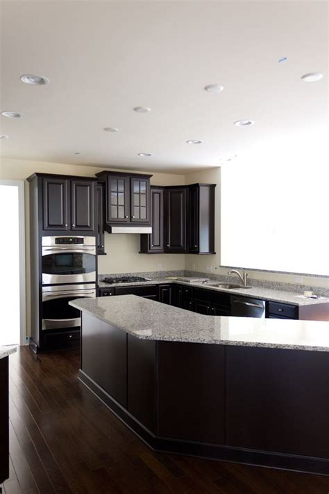 espresso kitchen cabinets with light floors pearl and espresso cabinets with hardwood