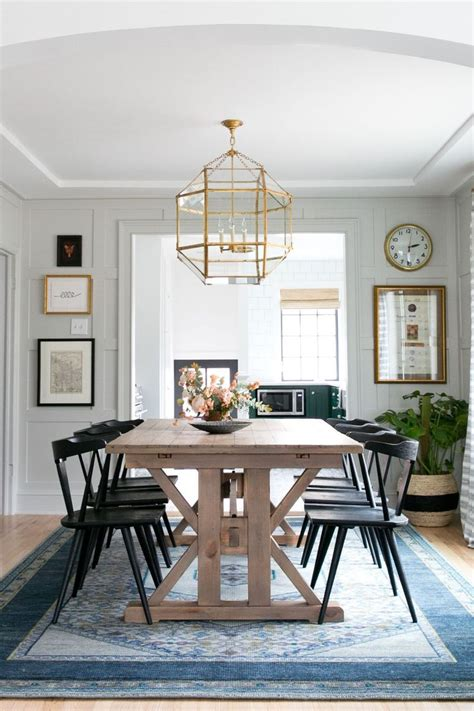 modern farmhouse dining room lighting this modern farmhouse dining room by studio mcgee gets