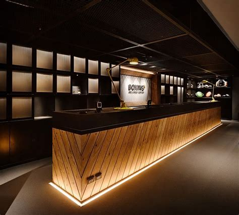 bar counter design boxing plus taipei taiwan dark counters wooden bar and solid surface
