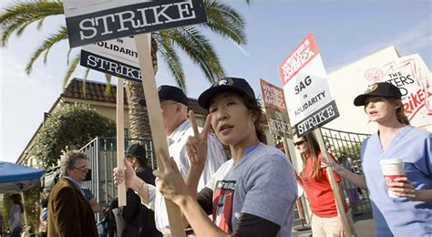 sandra oh new york times 2 studios escalate actions against striking writers the