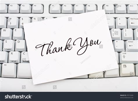 A Thank You Card Sitting On A Computer Keyboard, Online
