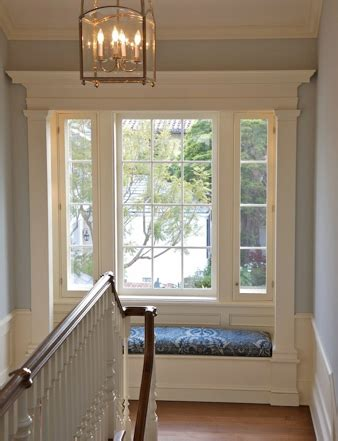 nooks and crannies window seat at the top of stairs trim around windows trim millwork