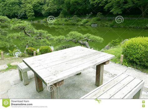 wooden outdoor furniture table and chair in zen garden