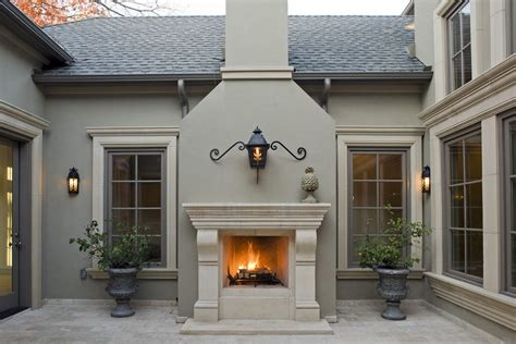 look inside houses with wall sconce and stone trim