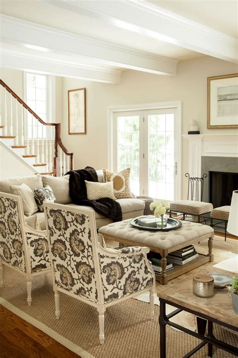 neutral living rooms neutral living room hip traditional large scale print on chairs two sofas facing each other
