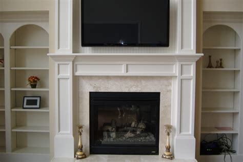 stoking  fire fireplace remodels