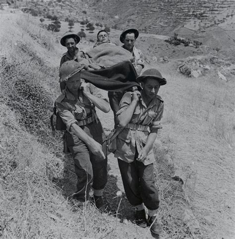 stretcher bearers carrying a wounded soldier in the area