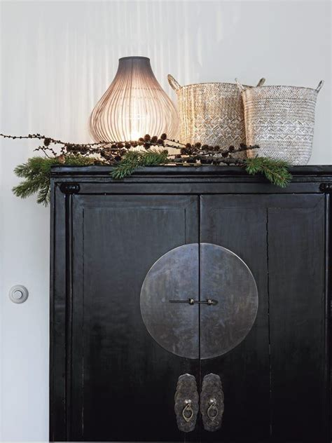 Decorating Ideas Top Of Armoire by Designing Home Thoughts On Decorating The Top Of An Armoire
