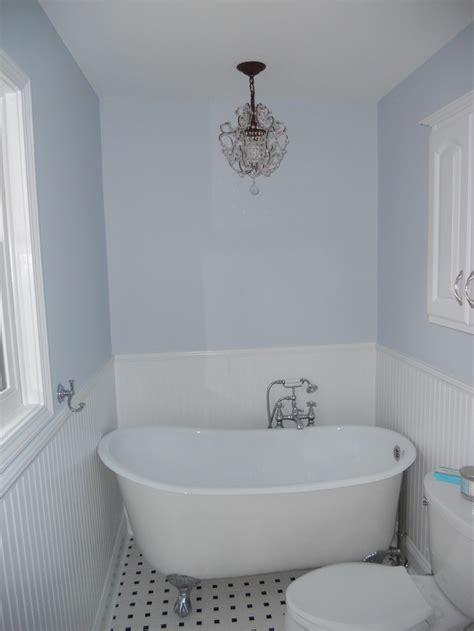chandelier over swedish slipper tub farmhouse bathroom