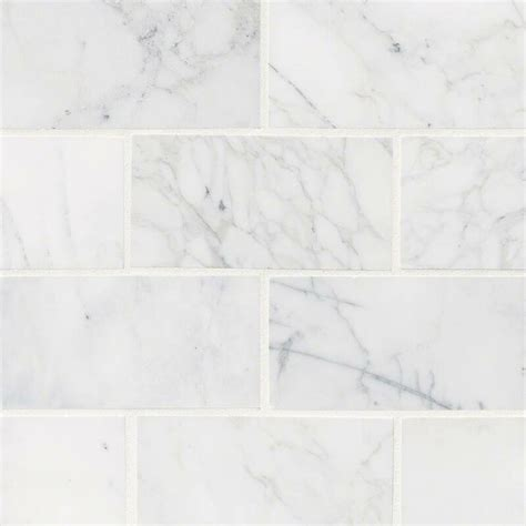 calacatta cressa honed    marble subway tile  white