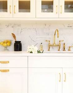 kitchen with gold accents transitional kitchen With best brand of paint for kitchen cabinets with gold and silver wall art