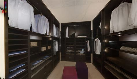 fitted mens wardrobe  rich wood  lighting interior