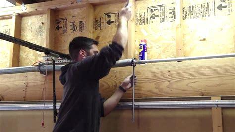 how to tighten torsion on garage door how to tighten the garage door