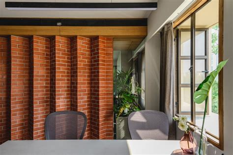 A brick veneer wall adds a lot of rustic warmth to your home. The Zig-Zag Brick Wall-Office Interiors   Wall interior design office, Office interiors, Brick wall
