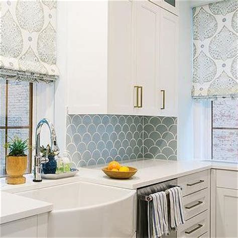 blue tile backsplash kitchen white upper cabinets and gray lower cabinets with gray kitchen island transitional kitchen