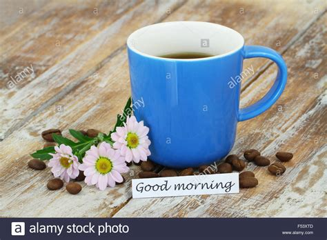 live wood coffee table morning card with mug of coffee pink daisies with