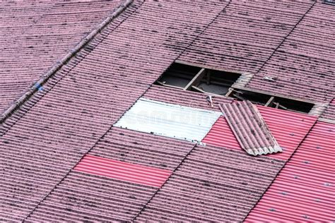 damaged  tiles roof   replacement stock photo
