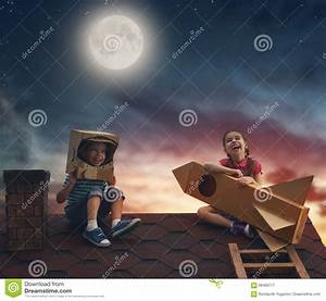 Children Playing On The Roof Stock Photo - Image: 69460717
