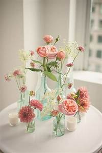 pink floral arrangements in glass bottles, photo by MGB ...