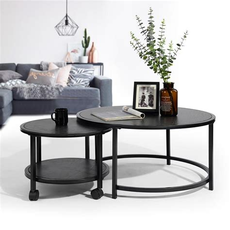 Union rustic ashwood round modular coffee table is a perfectly round, low table. Neka Black Wood Round Wheel Coffee Table (2-Piece) · QuikCompare