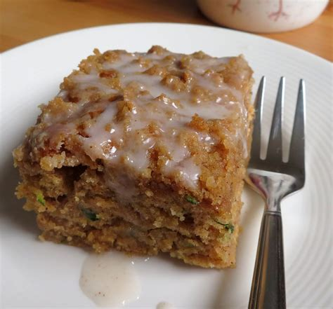 It's a lot like zucchini bread, moist and somewhat crumbly, but in sheet cake form, with more egg and sugar, and with a cream cheese frosting. The English Kitchen: Small Batch Zucchini Coffee Cake