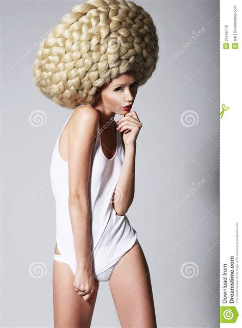 Ultramodern Hairstyle. Trendy Woman With Creative Art Wig