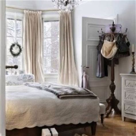 beige curtains light grey walls living rooom