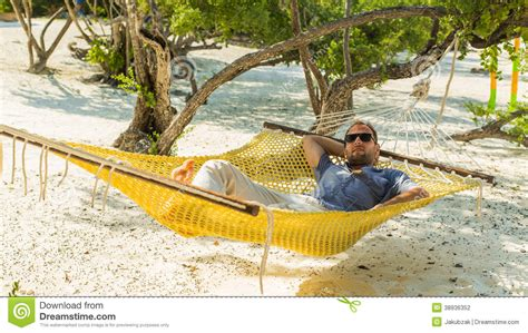 Relaxing On Hammock by Relaxing In A Hammock On The On Holidays Stock