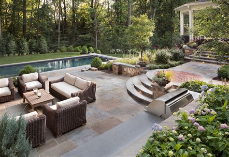 Backyard Patios by Should You Use Flagstone Or Pavers In Your Backyard Patio