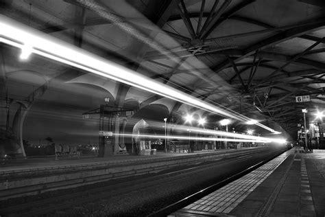 timelapse photo  greyscale train passing   stock