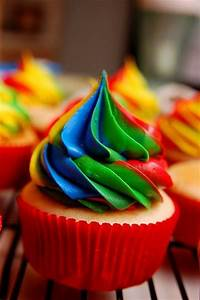rainbow frosting . frosted cupcake
