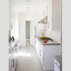 Contemporary Galley Kitchen With White Cabinets