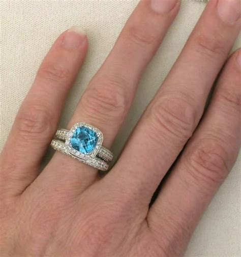 Cushion Cut Blue Topaz And Diamond Halo Engagement Ring. Message Bands. Emerald Cut Diamond Bands. 14k Anklet. Chain Watches. Beach Stud Earrings. Bell Necklace. Flowergirl Bracelet. Kunzite Engagement Rings