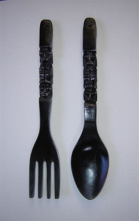 Fork and spoon wall decoration and related products have become an unmissable aspect of a comfortable lifestyle, remaining true to one's personality. Large carved wood fork and spoon wall art painted black