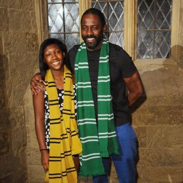 DOTING DADDY: Idris Elba Takes Daughter Isan To Warner ...