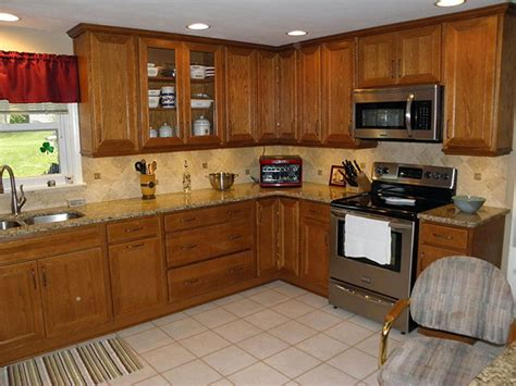 oak kitchen cabinets with granite countertop