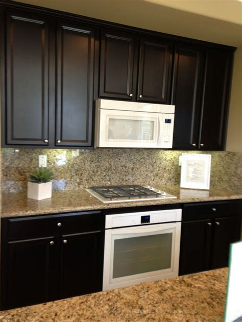 Kitchens With Cabinets by White Appliance Against Espresso Cabinets Meritage Model