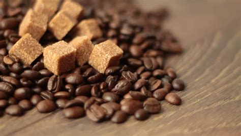 Best whole coffee bean products reviewed in february 2021 are all here. Coffee Beans With Sweet Brown Sugar Cubes Stock Footage Video 3110449 - Shutterstock