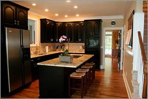 Kitchen with white cabinets and black appliances home for Kitchen cabinets lowes with black wall art and decor