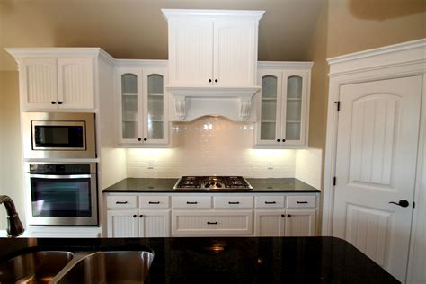 couto custom home painted cabinet finish sherwin williams universal khaki  walls sherwin
